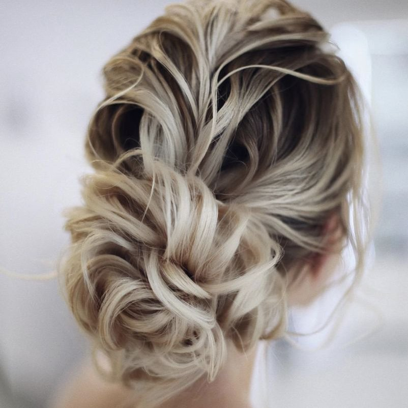 Hair updo for bride or maid of honor in a wedding.