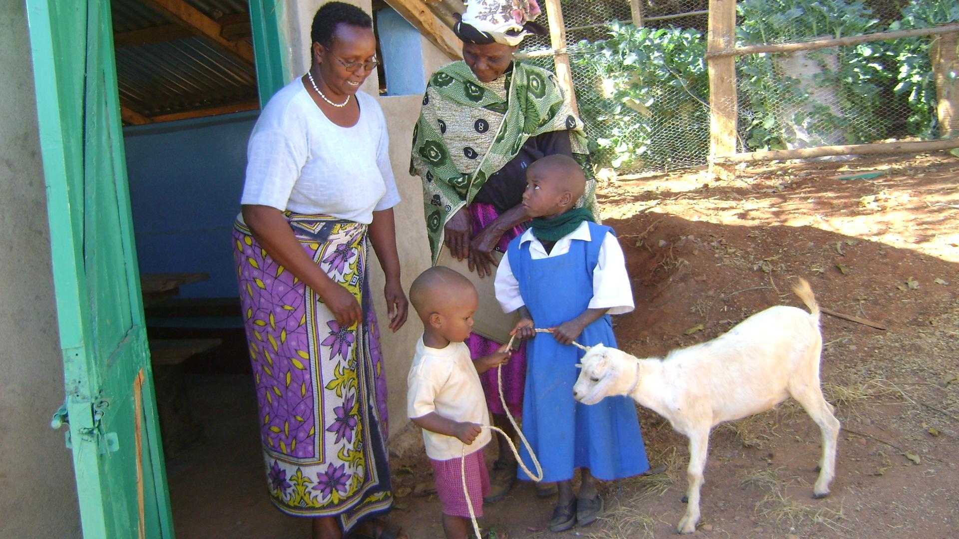 Faith receives her goat donated by Margaret Baker