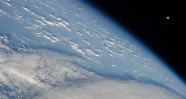 NASA: Earth's Clouds from above with Moon to the side