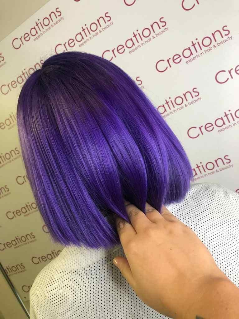 Purple bob haircut and colour