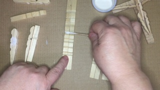 Photo of gluing first and second section of cross together.