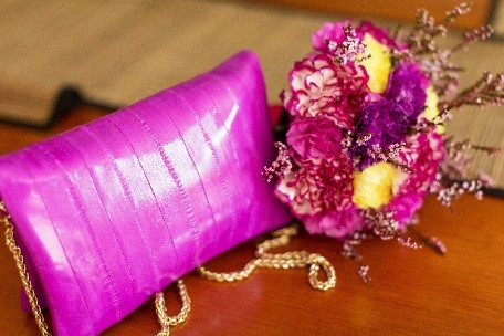 Fun and bright wedding purse and flowers in wedding bouquet