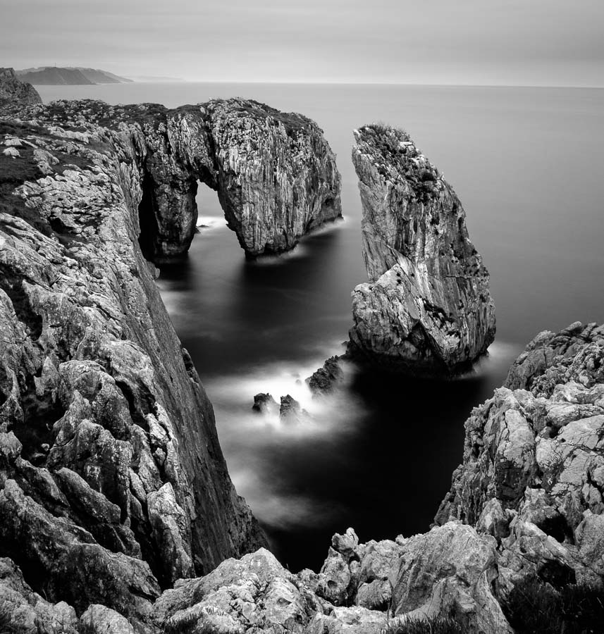 Black & white landscape photos of rock formations at Oliencu Cove, Asturias, Spain.