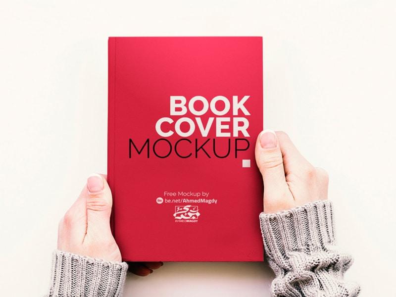 Free Hand Holding Book Cover Mockup Creative Sofa