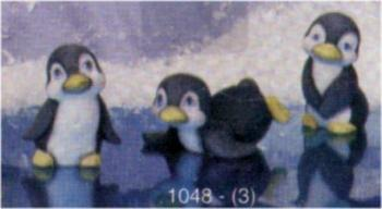 3 Penquins, two standing, one on belly w/ fins out