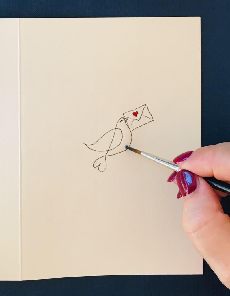 Man sieht eine Taube auf einer Valentinskarte von der Künstlerin Dodo Kresse.