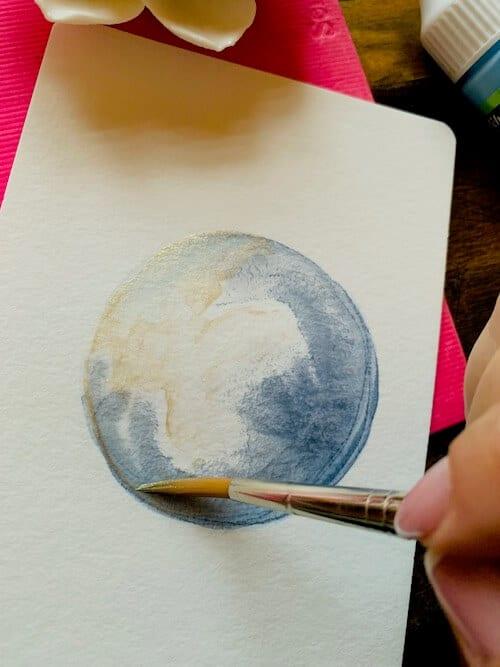 Die Welt entsteht steht auf einem Aquarell von Dodo Kresse