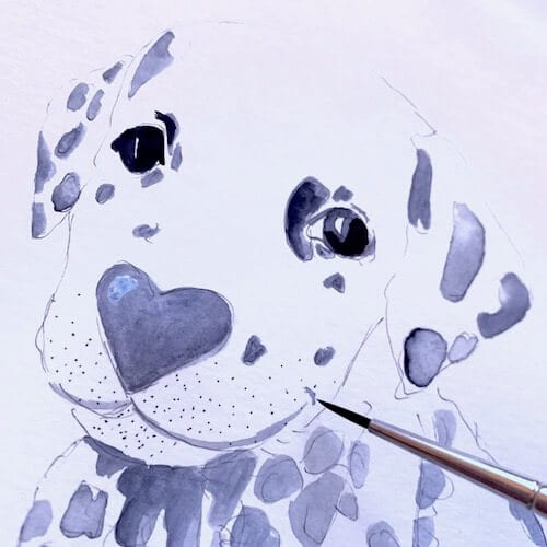 Man sieht wie Dodo Kresse mit dem Aquarellpinsel dem Dalmatiner ein Lächeln ins Gesicht zaubert.