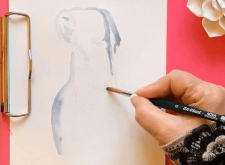 Man sieht wie Dodo Kresse eine Aquarellskizze von ihrem Windhund anfertigt.