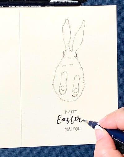 Man sieht eine Osterkarte, gemalt von Dodo Kresse für Creative Club, hier das Lettering im Detail