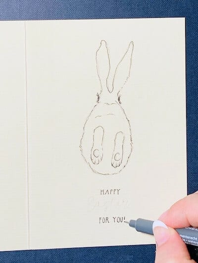 Man sieht eine Osterkarte, gemalt von Dodo Kresse für Creative Club, gelettert mit Happy Easter for you