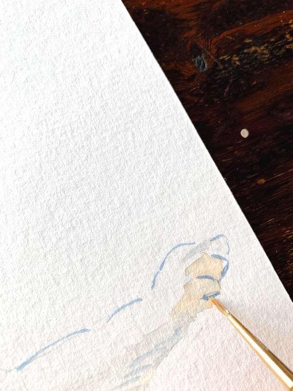 Hier siehst du wie Dodo die Pfote der Siamkatze mit Aquarellfarben malt