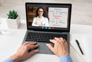 Unrecognizable woman having video call with business coach, using laptop