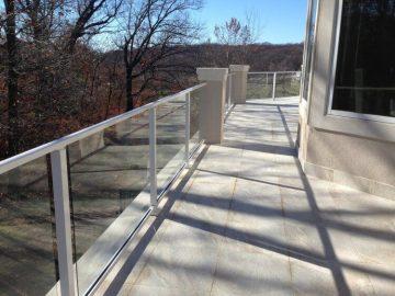 Tile deck, composite sub-floor, stucco columns, glass handrail, built in grill 2