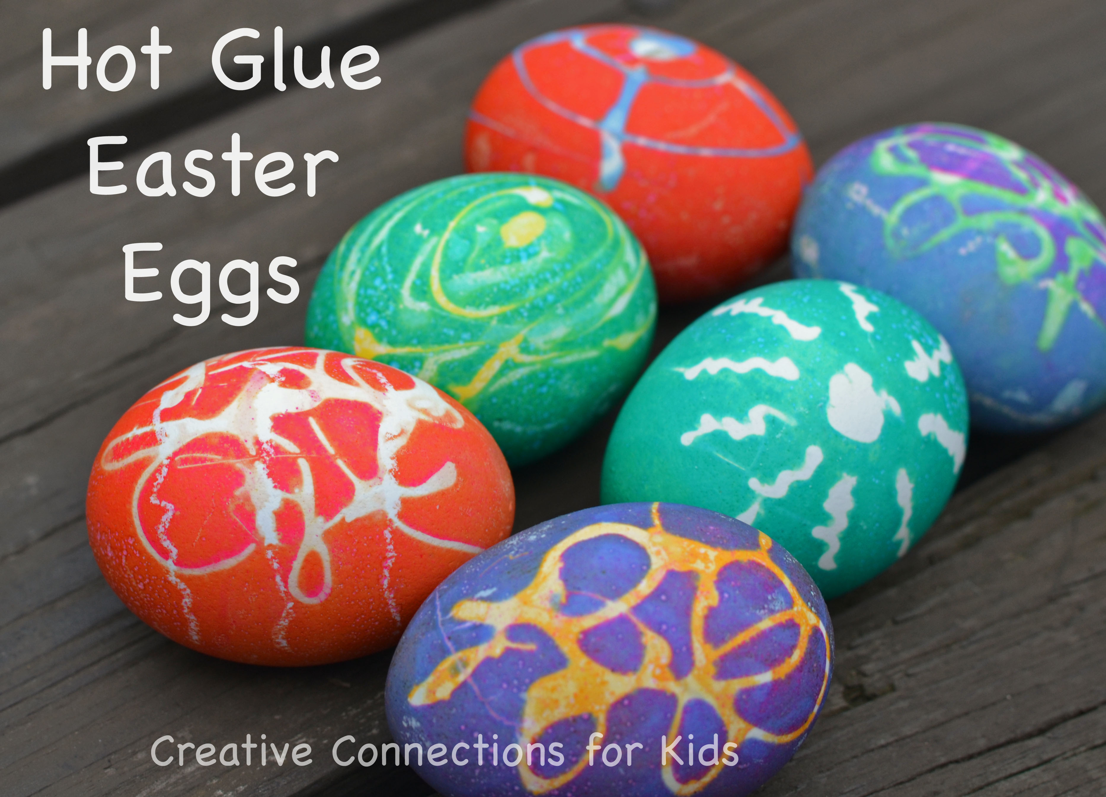 - Hot Glue + Color = Beautiful Easter Eggs
