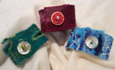 Cuffs/bracelets made with hand-made felt, embroidery and beading.