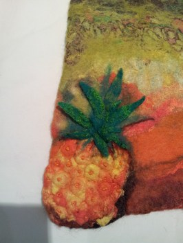 Closeup of the pineapple, showing 3D leaves and 'quilting' and embroidery of the pineapple giving it a pretty realistic look.