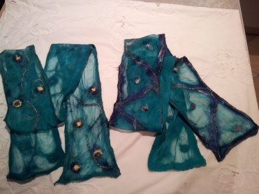 Two teal nuno felt scarves