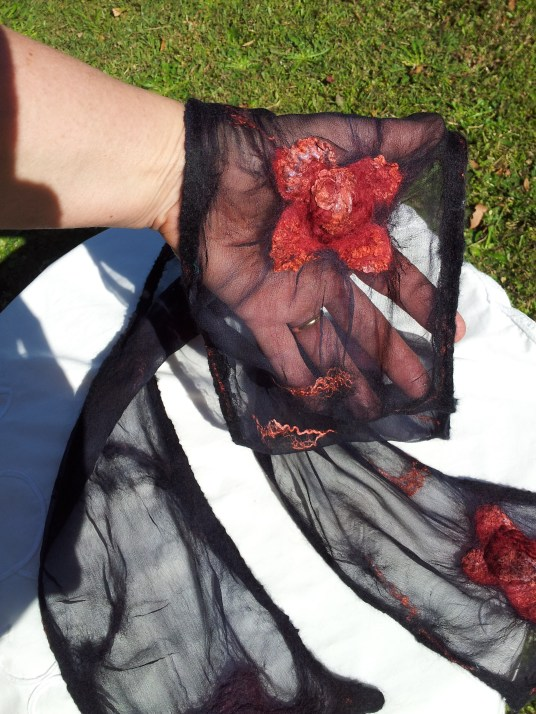 Roses on black scarf on hand