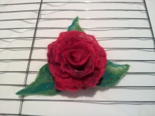 3D rose brooch drying on a rack in the kitchen.