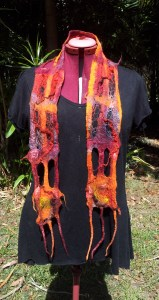Red network scarf with lots of hand dyed silk - hankies, tops, chiffon and dimensional yarn. Reds, oranges, maroon.