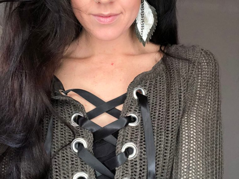 Refashion a knit sweater into a lace up one with this full step by step fashion tutorial