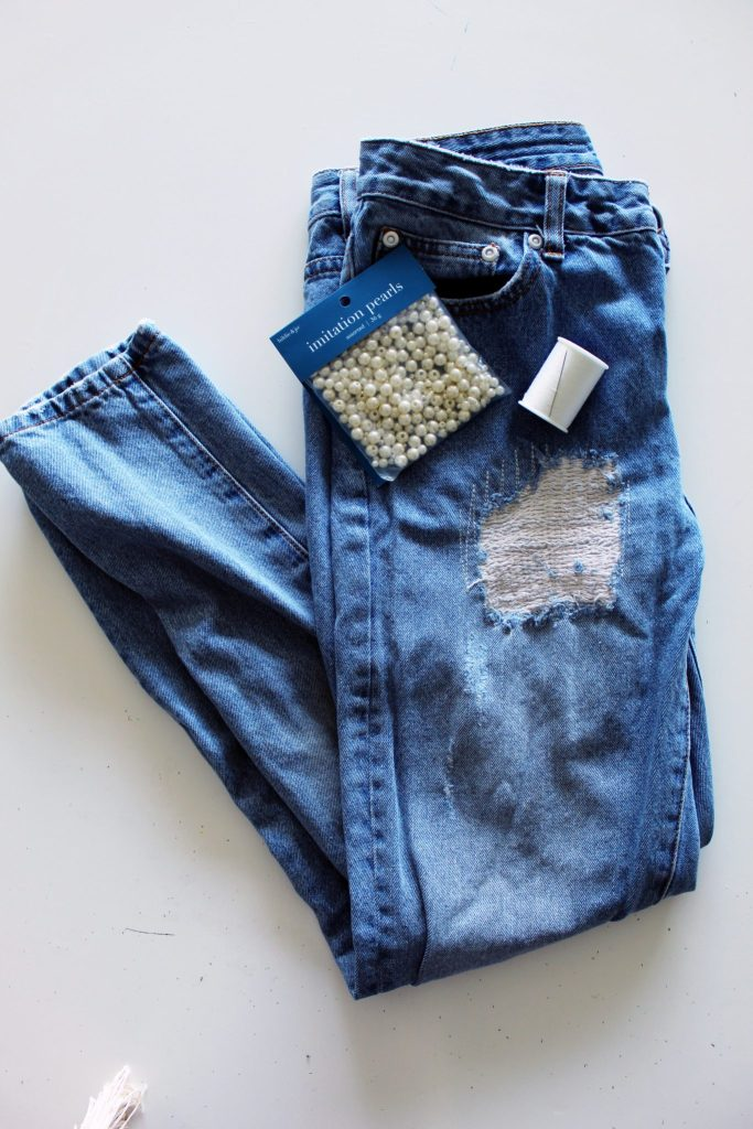 Add Pearls To Your Old Jeans for a new look . Denim refashion idea