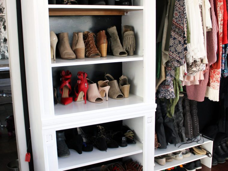 How to make a closet from an old bookcase. Click through for the full DIY tutorial