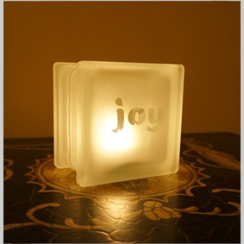 Glass block glass tealight candle holder with joy motif