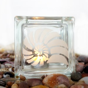 glass tea light candle holder with spiral shell motif