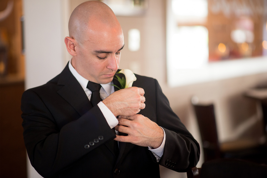 Groom prepares for Mendenhall Inn wedding ceremony