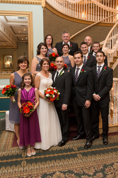 Bridal party group shot on stairs in Grand Ballroom at Mendenhall Inn