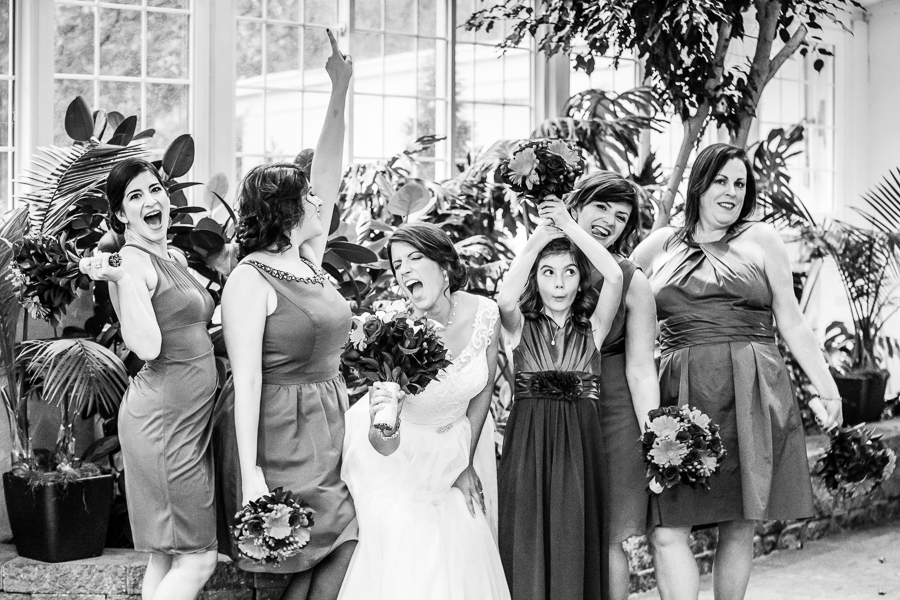 Bride and bridesmaids strike a pose at the Mendenhall Inn