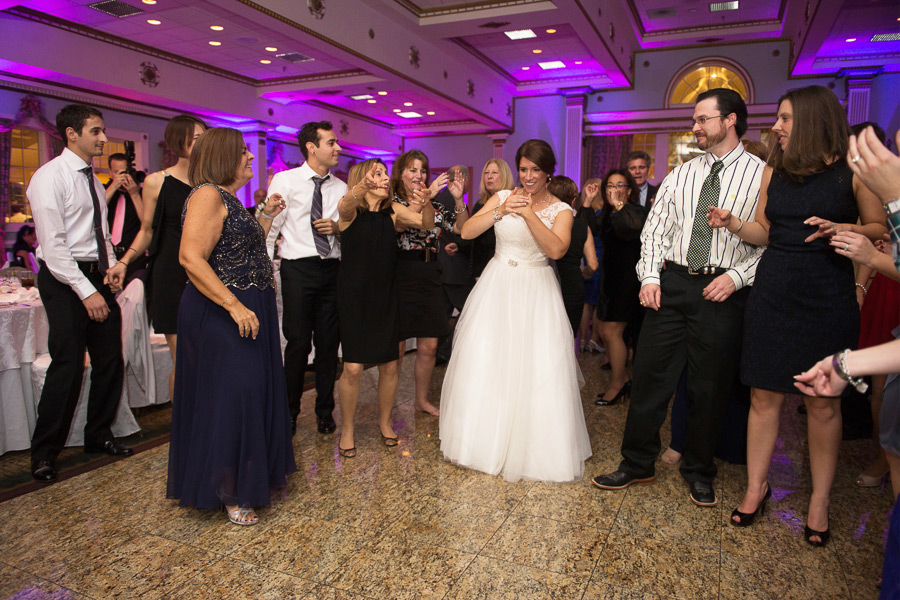 Bride enjoys dancing with guests