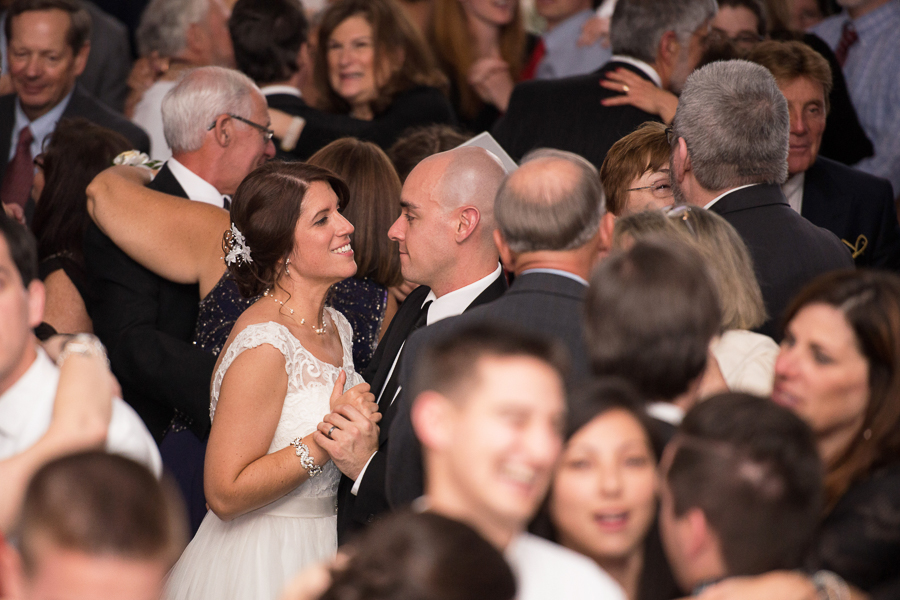 Bride and groom dancing in crowd at Mendenhall Inn wedding reception