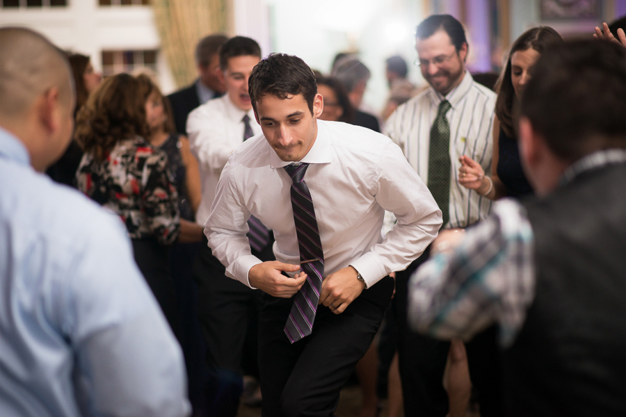 Groomsman dances at Mendenhall Inn wedding reception