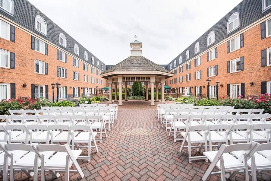 The courtyard and gazebo of the Hilton Christiana set up and ready for a wedding ceremony