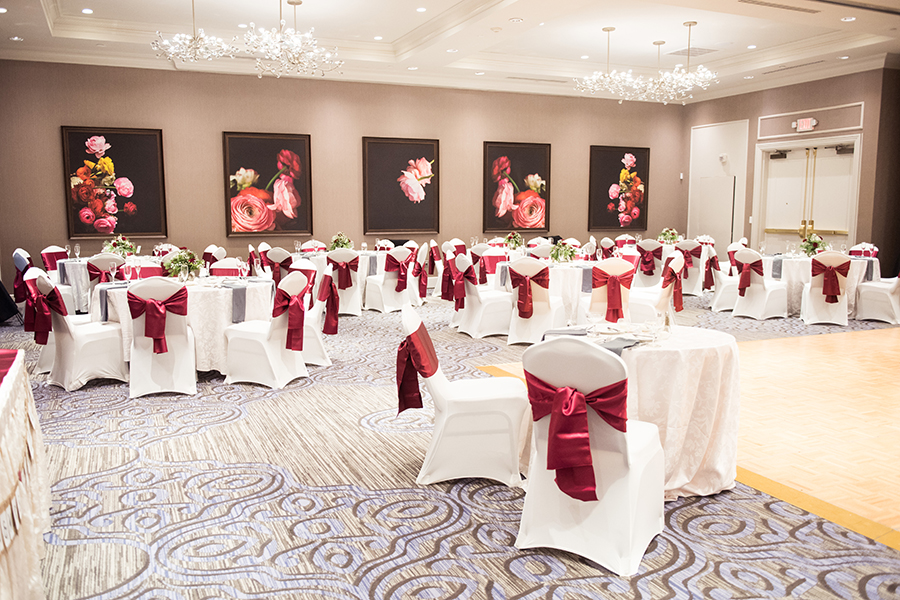 Hilton Christiana ballroom decorated for a wedding with red chair bows