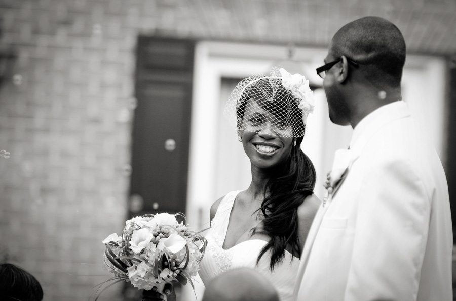 A bride smiles at her husband after they have been declared husband and wife
