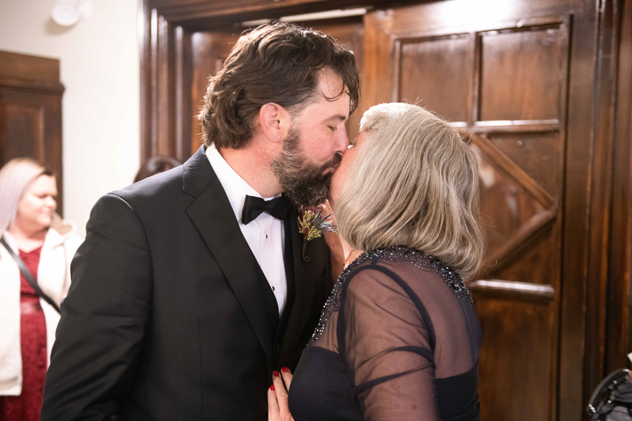 Groom kisses his mother on the cheek before ceremony starts