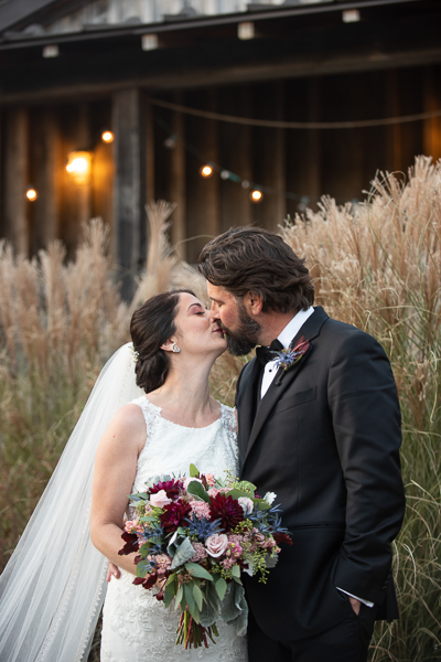 November wedding picture of bride and groom kissing at Galer Estate Winery in Pennsylvania