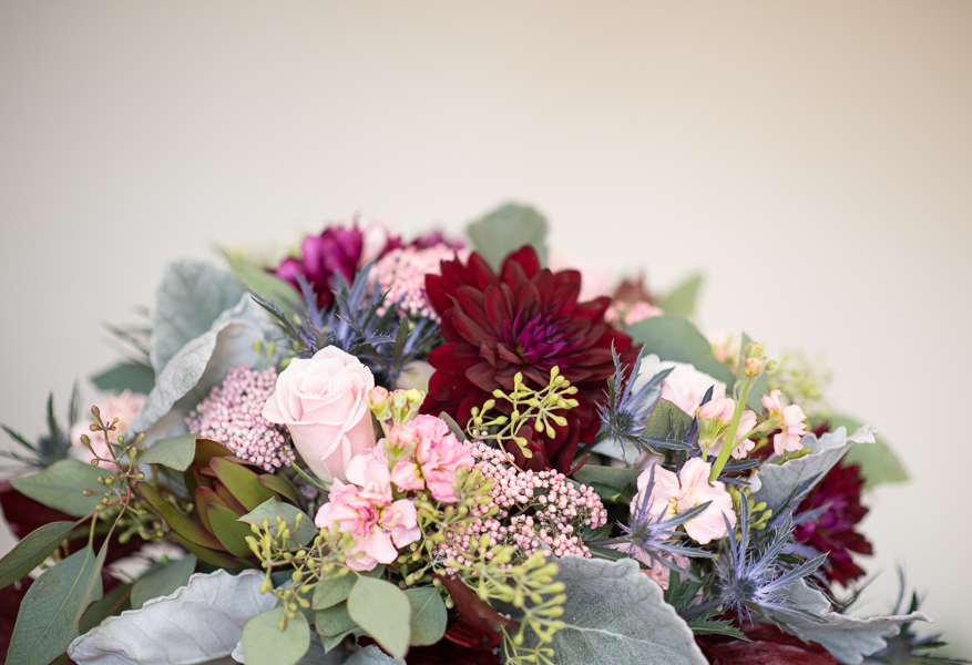 Close up of bridal bouquet with pinks and burgundies and blues for a wedding at The Farmhouse in Delaware