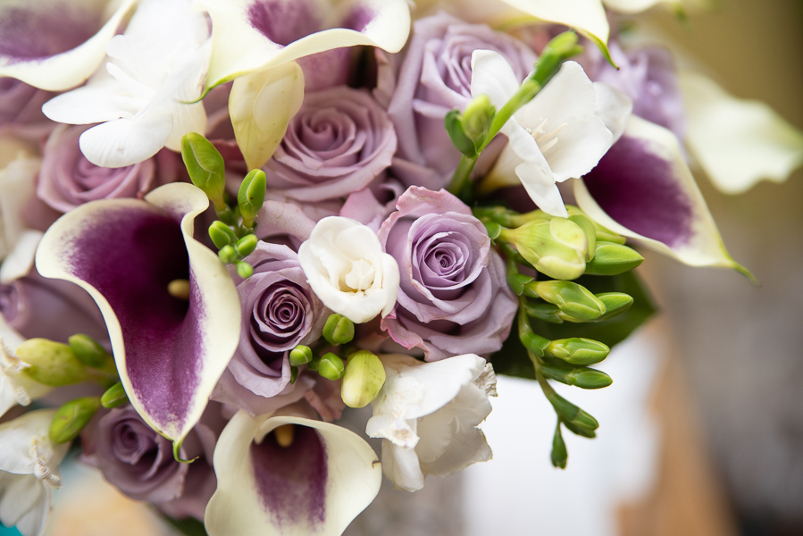 November wedding bouquet with purples and ivory