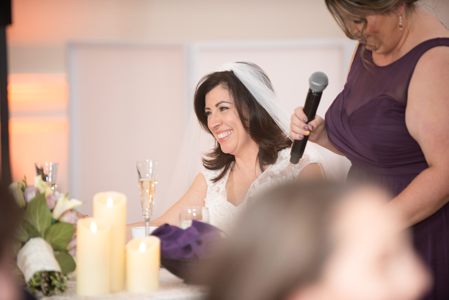 Bride smiles as matron of honor gives speech