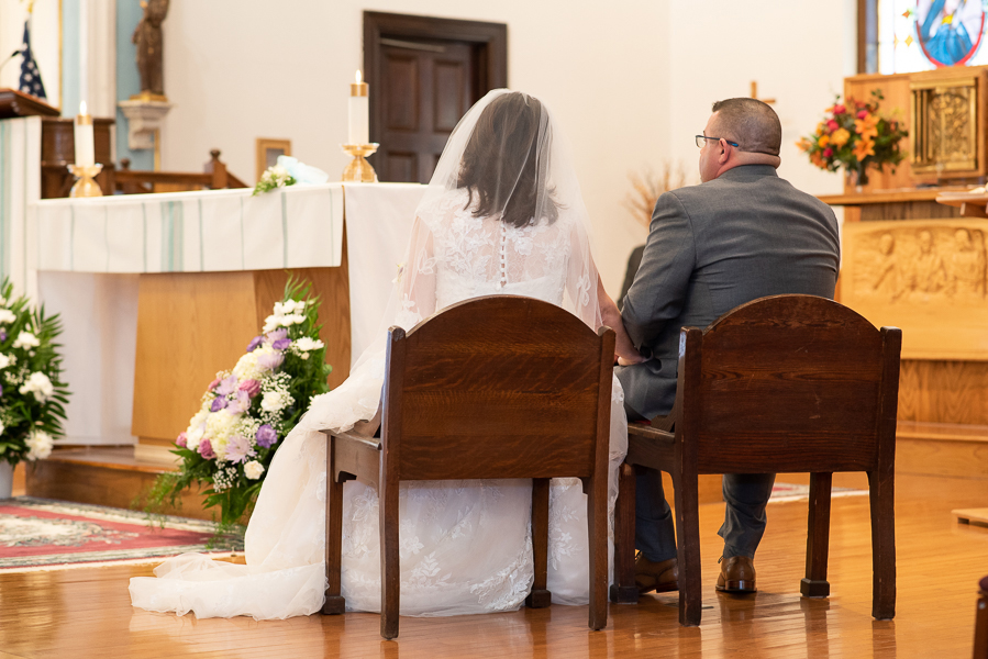 Bride and groom sitting during wedding ceremony