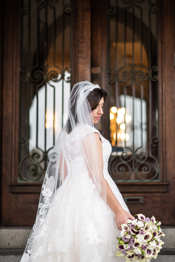 Bride poses in front of beautiful doors at University and Whist Club