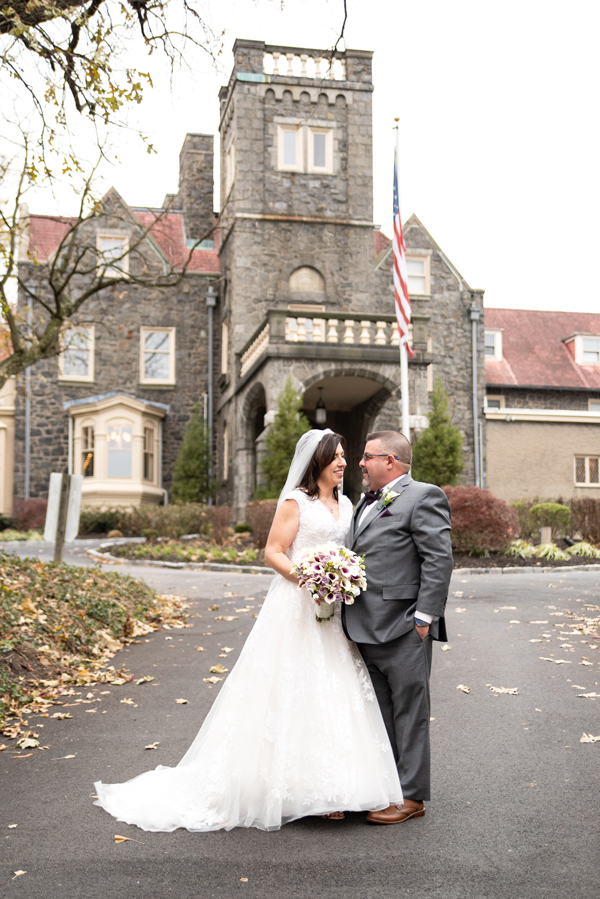 Bride and groom standing in front of Historic University and Whist Club