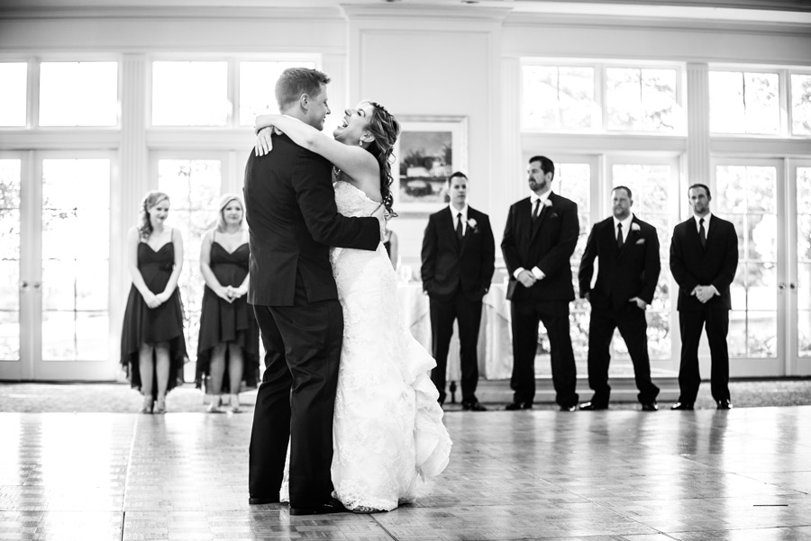 Black and white of first dance with bride laughing