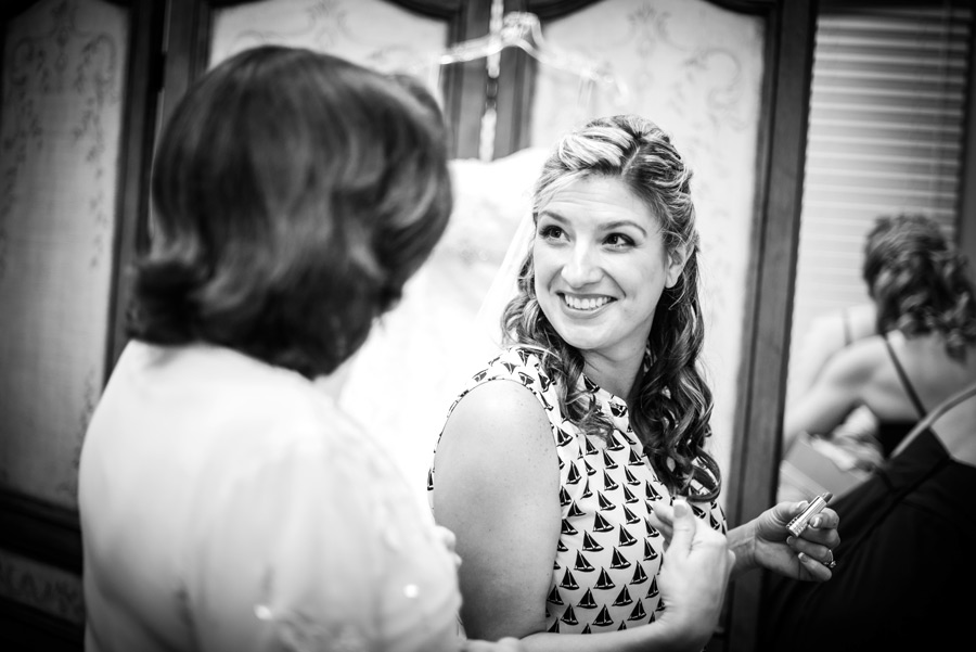 Black and white image of bride smiling at her mom on her wedding day at Deerfield