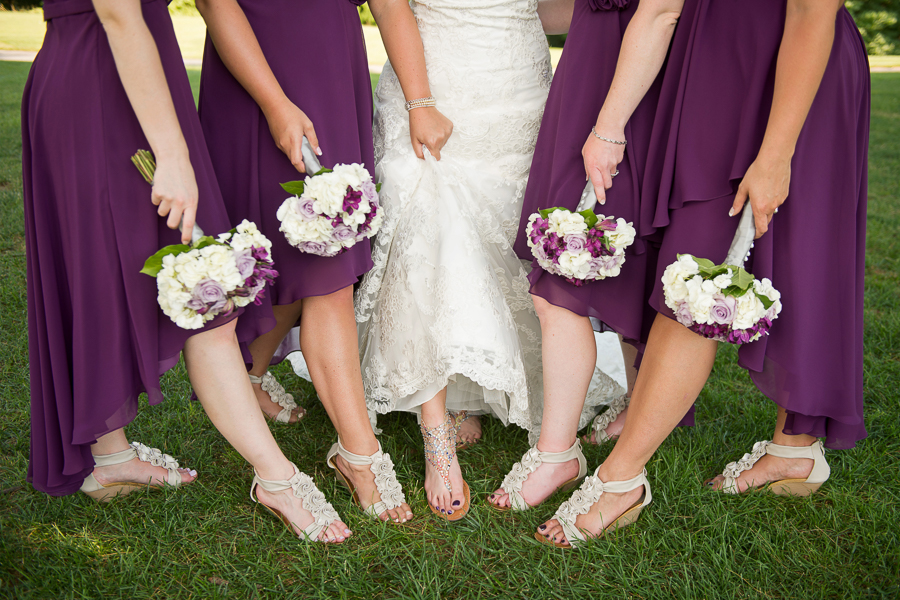 Closeup of bride and bridesmaids shoes and bouquets
